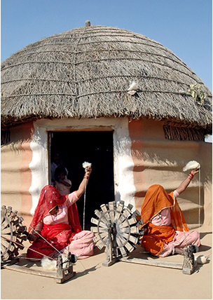 Women weaver making yarn - Craftmenship- m
