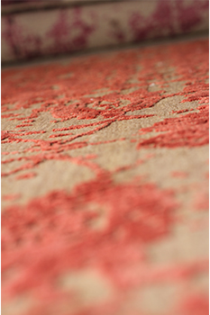 Orange color finished handmade rug